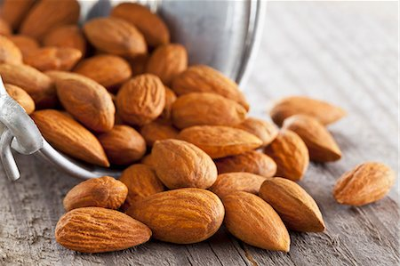 release - Whole almonds falling out of a metal bucket Stock Photo - Premium Royalty-Free, Code: 659-07610034