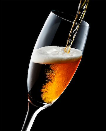 pouring - Cold Beer Pouring From a Bottle into a Glass; Overflowing Stock Photo - Premium Royalty-Free, Code: 659-07610066