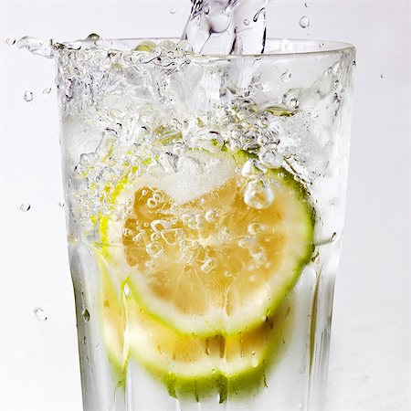 drinking water glass - Water being poured into a glass of lime slices Stock Photo - Premium Royalty-Free, Code: 659-07610078