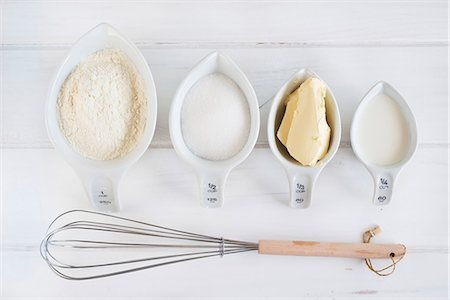 still life - Baking Ingredients; Bowl of Flour; Eggs; Whisk Stock Photo - Premium Royalty-Free, Code: 659-07610196