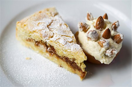 recipe - A slice of almond tart with almond ice cream Stock Photo - Premium Royalty-Free, Code: 659-07610259