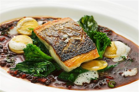 Sea bass in olive gravy Stock Photo - Premium Royalty-Free, Code: 659-07610347