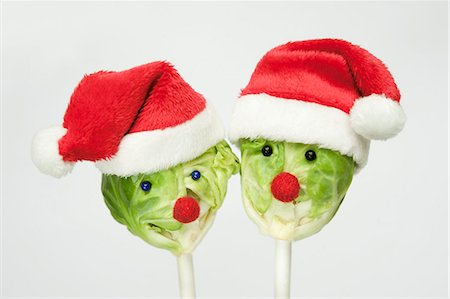 picture of a red lollipop - Two Brussels sprouts on sticks with Christmas hats and faces Stock Photo - Premium Royalty-Free, Code: 659-07739217