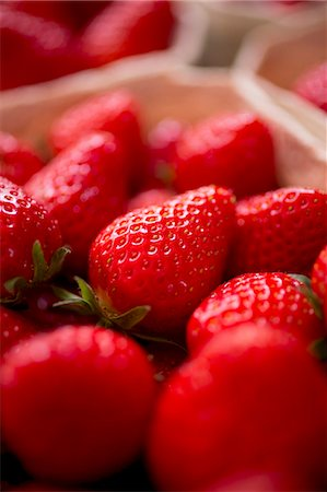 strawberries - Fresh strawberries in a paper punnet (close-up) Stock Photo - Premium Royalty-Free, Code: 659-07739415