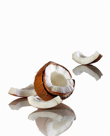 A open coconut on a white surface Stock Photo - Premium Royalty-Free, Code: 659-07739517