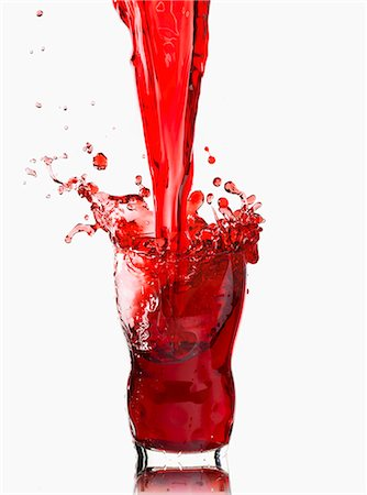 dripping silhouette - Cherry juice being poured and splashing Stock Photo - Premium Royalty-Free, Code: 659-07739529