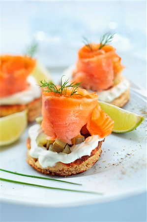 smoked - Blinis topped with smoked salmon, cream and gherkins Stock Photo - Premium Royalty-Free, Code: 659-07958653