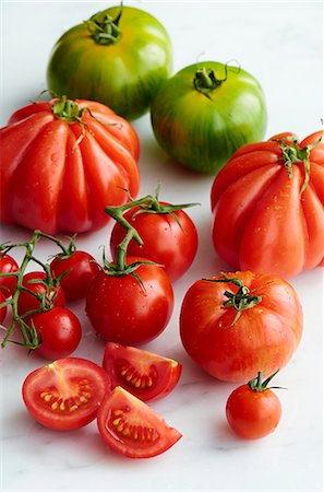 fresh - Various types of tomatoes with drops of water Stock Photo - Premium Royalty-Free, Code: 659-07958701