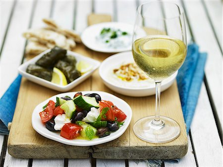 Greek food, white wine and unleavened bread Stock Photo - Premium Royalty-Free, Code: 659-07958858