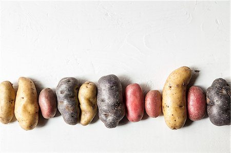 purple - A row of various potatoes Stock Photo - Premium Royalty-Free, Code: 659-07958928