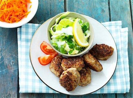 recipe - Meat patties with a carrot and cabbage salad Stock Photo - Premium Royalty-Free, Code: 659-07958972