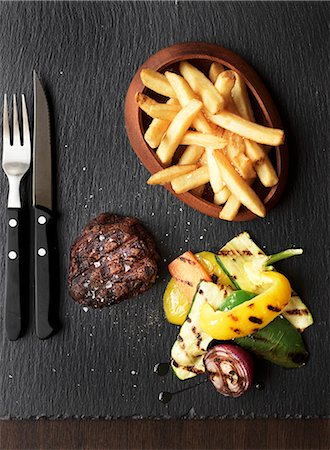 Grilled beef steak with chips and grilled vegetables Stock Photo - Premium Royalty-Free, Code: 659-07958998
