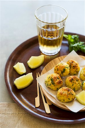 portuguese (places and things) - Bolinhos de Bacalhau (stockfish fritters, Portugal) Stock Photo - Premium Royalty-Free, Code: 659-07959120