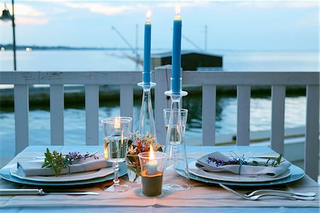 A table laid outside at dusk Stock Photo - Premium Royalty-Free, Code: 659-07959331
