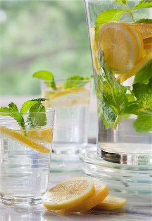 drink (non-alcohol) - Lemon water with mint in two glasses and a jug Stock Photo - Premium Royalty-Free, Code: 659-07959372
