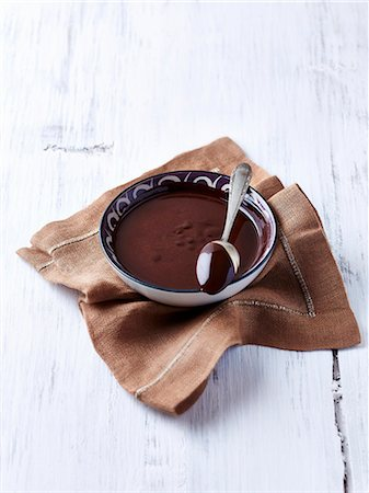 A bowl of melted chocolate and a spoon Stock Photo - Premium Royalty-Free, Code: 659-07959451