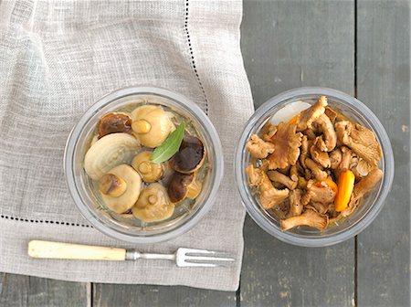 fork - Preserved bay boletes and chanterelle mushrooms Stock Photo - Premium Royalty-Free, Code: 659-07959595