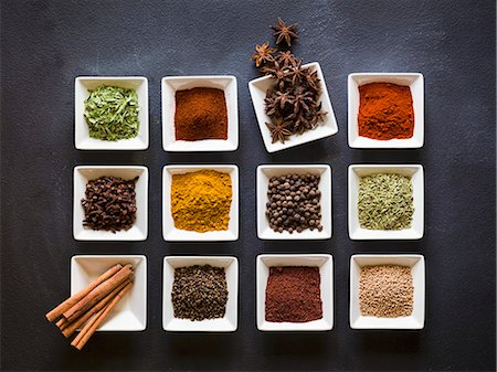 pimento - Various spices in square dishes on a chalkboard surface Stock Photo - Premium Royalty-Free, Code: 659-08147053