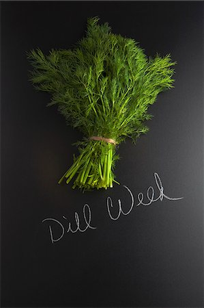 descriptive - Fresh dill on a slate surface with a label Stock Photo - Premium Royalty-Free, Code: 659-08147212
