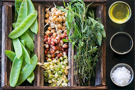 salt - Bean sprouts, mange tout and herbs in a wooden crate next to olive oil, balsamic vinegar and sea salt Stock Photo - Premium Royalty-Free, Code: 659-08147342