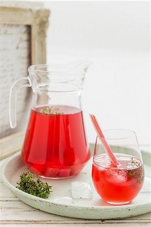 Rhubarb iced tea in a glass and a jug Stock Photo - Premium Royalty-Free, Code: 659-08147532