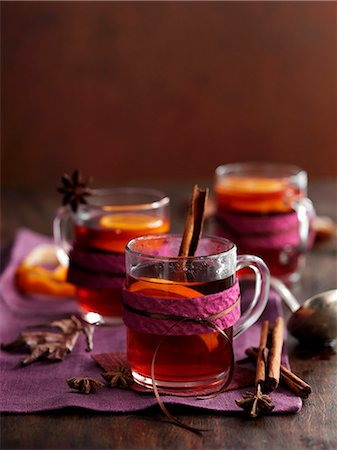 Glasses of mulled wine with cinnamon, anise and orange slices Stock Photo - Premium Royalty-Free, Code: 659-08147796