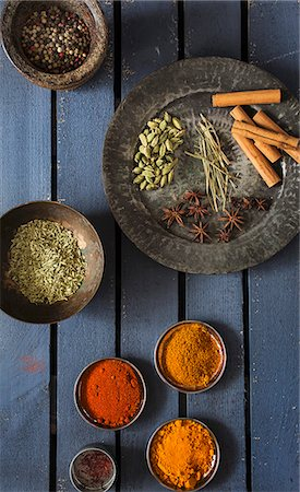 Various spices in bowls and on a plate Stock Photo - Premium Royalty-Free, Code: 659-08147987