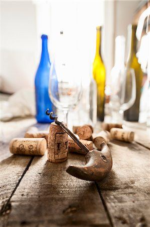 A corkscrew, corks, empty wine bottles and glasses Stock Photo - Premium Royalty-Free, Code: 659-08418701