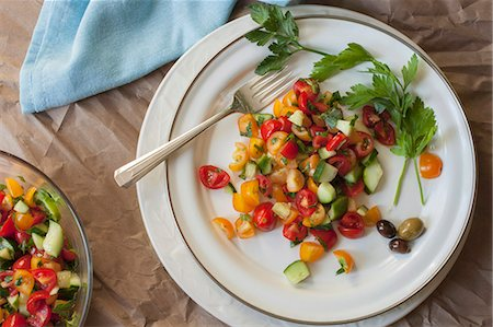 salad - Israeli tomato and cucumber salad on a white plate Stock Photo - Premium Royalty-Free, Code: 659-08419754