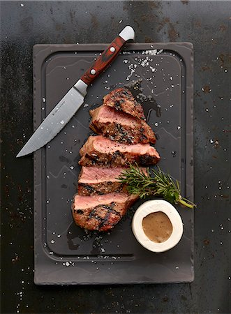 A grilled ribeye steak with sauce Stock Photo - Premium Royalty-Free, Code: 659-08420114