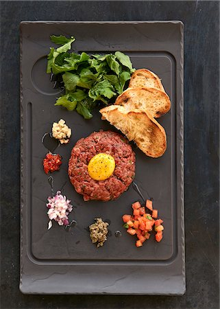 rectangle - Beef tatar with an egg yolk and grilled bread Stock Photo - Premium Royalty-Free, Code: 659-08420118