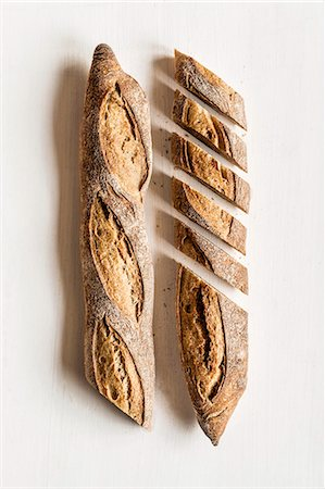 food - Baguettes, one sliced Stock Photo - Premium Royalty-Free, Code: 659-08512996