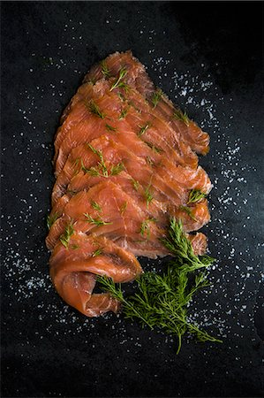smoked - Slices of smoked salmon with sea salt flakes and dill Stock Photo - Premium Royalty-Free, Code: 659-08897199