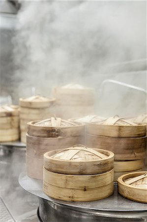 Bamboo steaming baskets in a steamy kitchen in China Stock Photo - Premium Royalty-Free, Code: 659-08897344