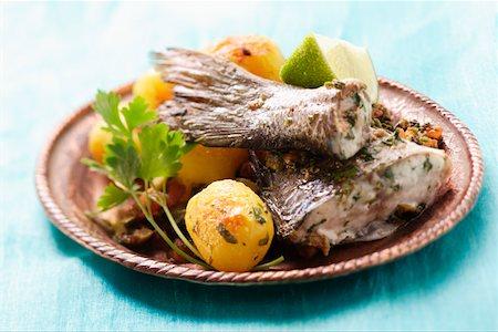 Sea bass with roast potatoes (Morocco) Stock Photo - Premium Royalty-Free, Code: 659-01845489