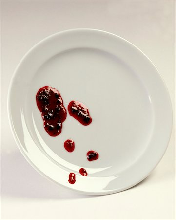 spot (dirt mark) - Blobs of jam on a plate Stock Photo - Premium Royalty-Free, Code: 659-01849475