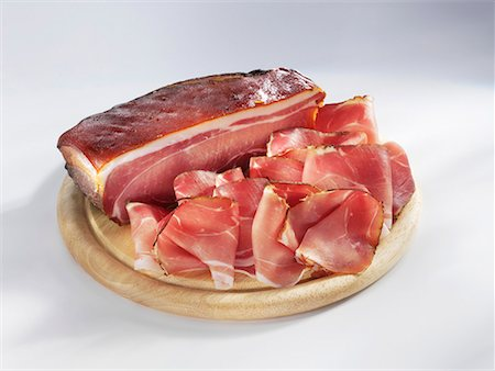 smoked - Smoked Schinkenspeck (dry-cured pork), a piece and sliced Stock Photo - Premium Royalty-Free, Code: 659-01854237