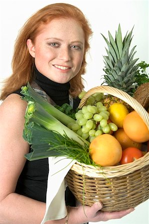 Young woman holding a basket of fruit and vegetables Stock Photo - Premium Royalty-Free, Code: 659-01855145