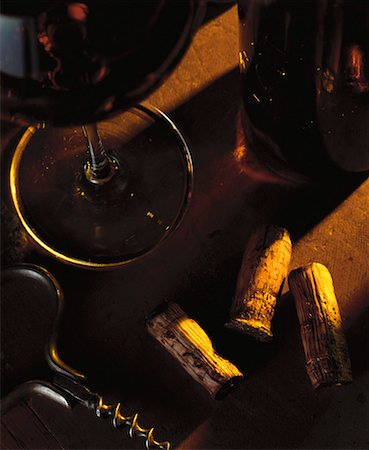 Still life with red wine, wine corks and corkscrew Stock Photo - Premium Royalty-Free, Code: 659-01850066