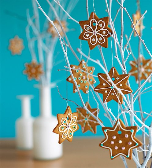 Ginger biscuits as Christmas decorations Stock Photo - Premium Royalty-Free, Image code: 659-01852950
