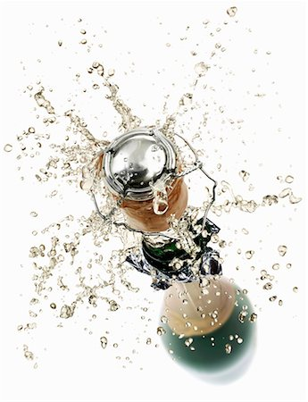Cork flying out of a sparkling wine bottle Stock Photo - Premium Royalty-Free, Code: 659-01861413