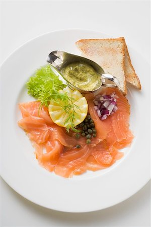 smoked - Smoked salmon with capers, mustard & dill sauce and toast Stock Photo - Premium Royalty-Free, Code: 659-01863967