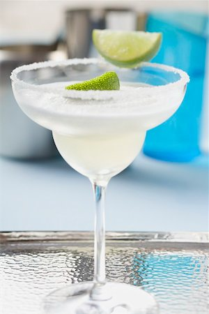 Margarita with lime wedges in a glass with a salted rim Stock Photo - Premium Royalty-Free, Code: 659-02212402