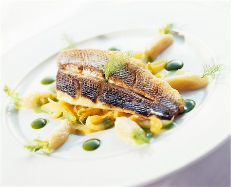 Fried sea bass on vegetables with pesto Stock Photo - Premium Royalty-Free, Code: 659-03524061