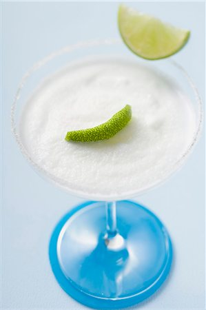 Margarita with lime wedges in a glass with a salted rim Stock Photo - Premium Royalty-Free, Code: 659-03524408