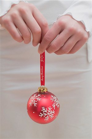 Woman holding red Christmas bauble Stock Photo - Premium Royalty-Free, Code: 659-03525264