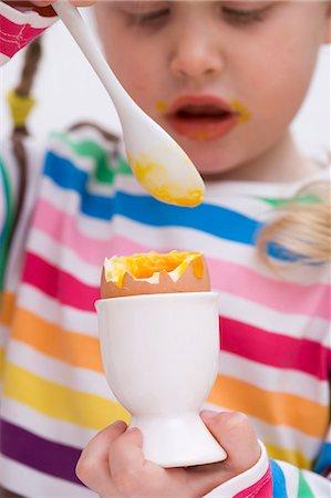 Little girl eating soft-boiled egg Stock Photo - Premium Royalty-Free, Code: 659-03529415
