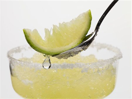 Frozen Margarita, lime wedge on spoon Stock Photo - Premium Royalty-Free, Code: 659-03529590