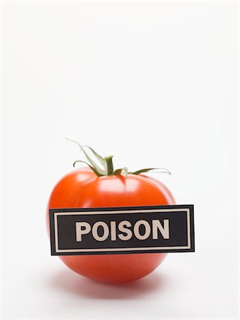 poison - Tomato with a 'POISON' label Stock Photo - Premium Royalty-Free, Code: 659-03529689