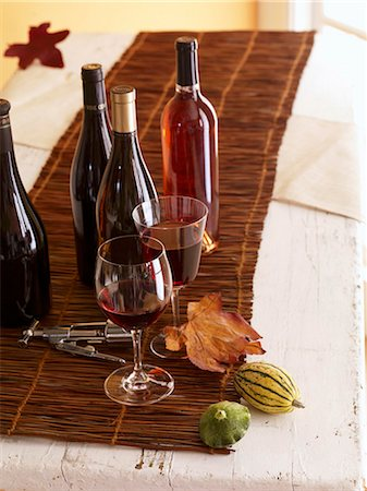 Bottles and Glasses of Wine with Corkscrew Stock Photo - Premium Royalty-Free, Code: 659-03521252